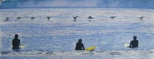 Surfers Watching a Squadron of Pelicans